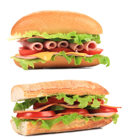 Two appetizing sandwiches with cheese and sausage  photo