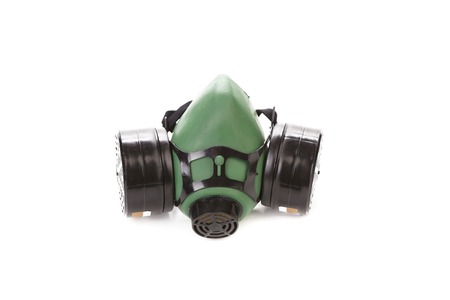 dust mask: Side view of green gas mask. Isolated on a white background.