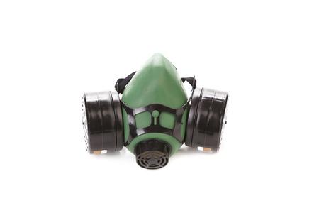 mascara gas: Vista lateral de la máscara de gas verde. Aislado en un fondo blanco.