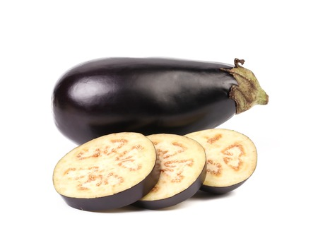 Large single eggplant and slices. Isolated on a white background. photo