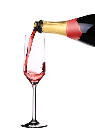 Red champagne pouring in a glass. Isolated on a white background. photo