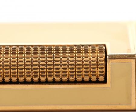 gas lighter: Metal flint golden on gas lighter. Whole background.