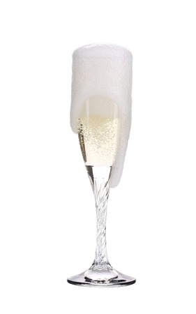 trickles: Elegant champagne glass. Champagne trickles on white background