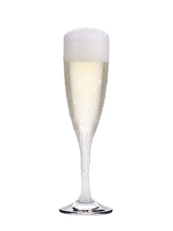 Elegant full champagne glass. Trickles. Isolated on a white background photo