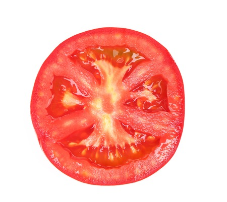 Tomato slice isolated on white background, top view Foto de archivo