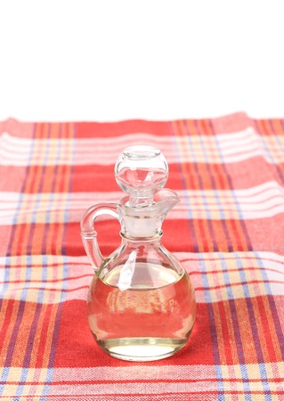 acetic acid: Vinegar in glass carafe on table. Isolated on a white background.