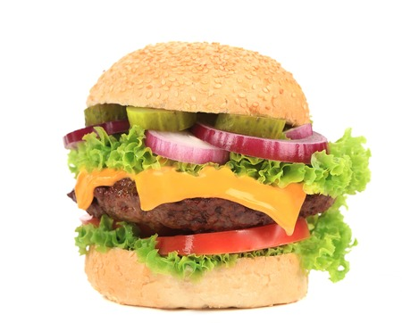 Big appetizing fast food hamburger. Isolated on a white background. photo