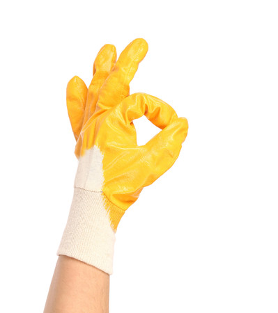 okey: Okey sign with orange rubber glove. Isolated on a white background.