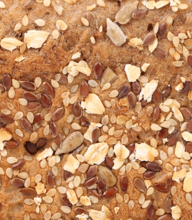 Bread oat flakes and sesame seeds coriander. Whole background. photo