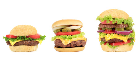 Three appetizing hamburgers. Isolated on a white background. photo