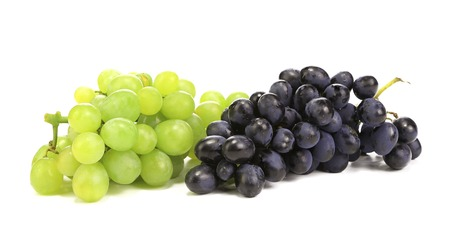 Black and green ripe grapes. Isolated on a white backgropund. Stock Photo
