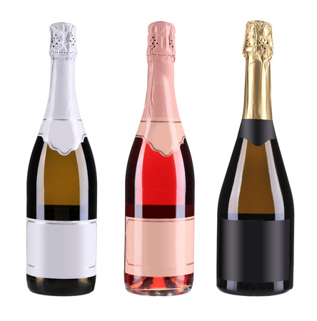 Three bottles of champagne.  Isolated on white background photo