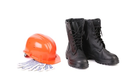 Kersey boots and hard hat on gloves. Isolated on a white background. photo