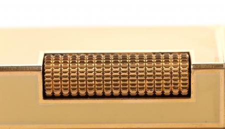 flint: Metal flint golden on gas lighter. Whole background.