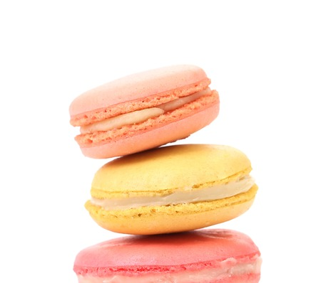 Stack of macaron cakes. Isolated on a white background. photo
