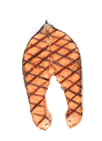 Close up of grilled salmon steak. Isolated on a white background. photo