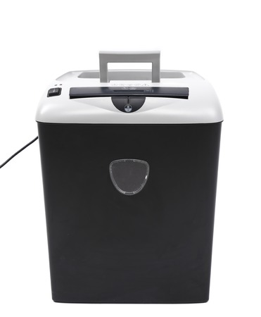 Close up of paper shredder. Isolated on a white background. photo