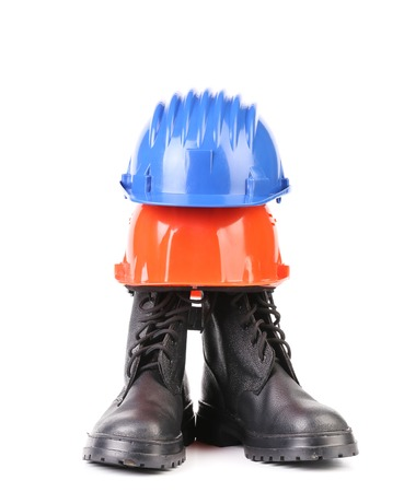 Hard hat and working boots. Isolated on a white . photo