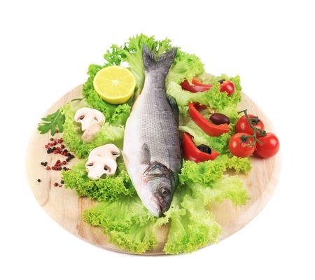 Fresh seabass on platter with lettuce.  photo