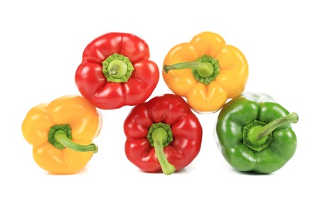 Colorful sweet pepper pyramid. Isolated on a white . photo