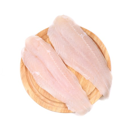 pangasius: Fresh fillet of pangasius. Isolated on a white .
