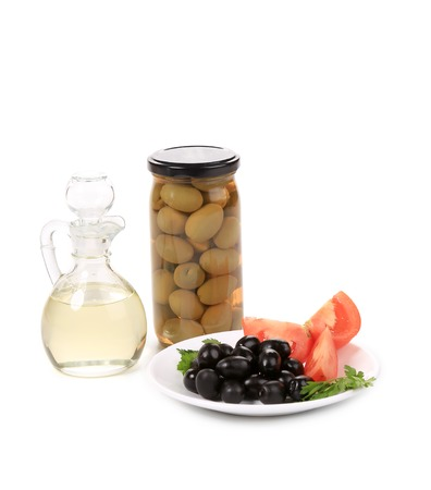 acetic: Bottle and bowl of olives with vinegar. Isolated on a white background.