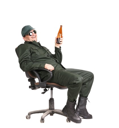 Worker in glasses sitting with beer. Isolated on a white background. photo