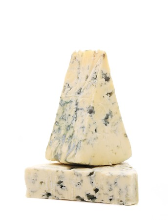 Slice of dor blue cheese. Isolated on a white background. photo