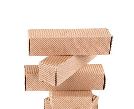 shipped: Stack of cardboard boxes.  Isolated on white background Stock Photo