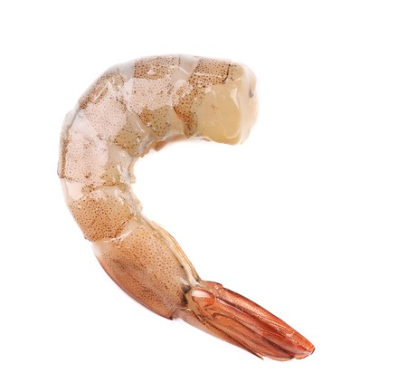 Piece of raw shrimp.  Isolated on white background photo