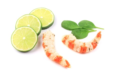 Cooked unshelled shrimps with basil. Isolated on a white background. photo