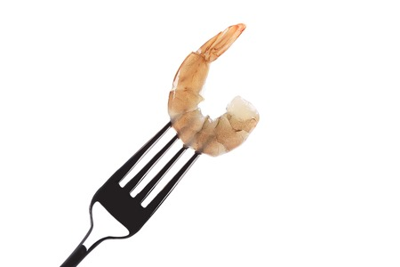 Shrimp on fork. Isolated on a white background. photo