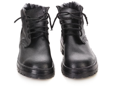 Pair of winter black boots. Isolated on a white background. photo