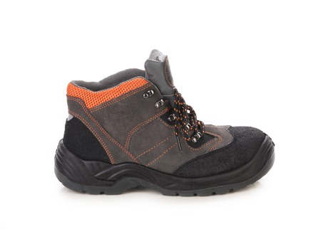 Black mans boot with orange inset.  photo