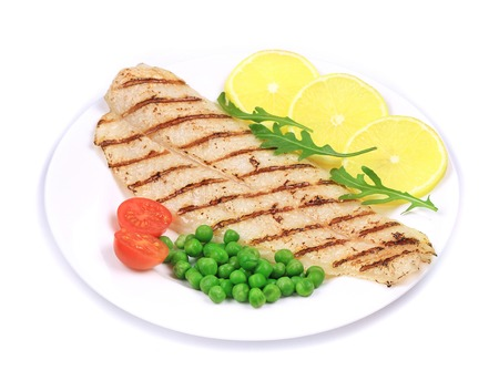pangasius: Pangasius fillet on plate. Isolated on a white background.