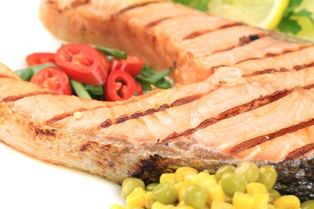 Grilled salmon filler with vegetables. Whole background. photo