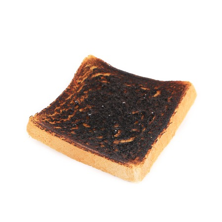 burnt toast: Burnt toast isolated on a white background. Stock Photo