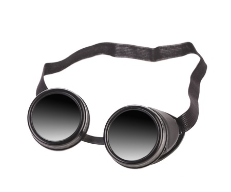 Black goggles used for eye protection and fashion statement. Isolated on a white background. photo