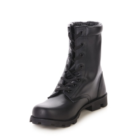 Black leather boot with laces. Isolated on a white background. photo