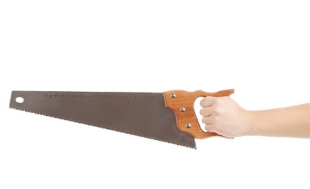 Close up of hand in gloves with saw. Isolated on a white background. photo