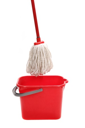 tidiness: Red bucket with cleaning mop. Isolated on a white background. Stock Photo