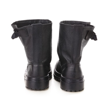 Black kersey pair of boots close up. Isolated on white background. photo