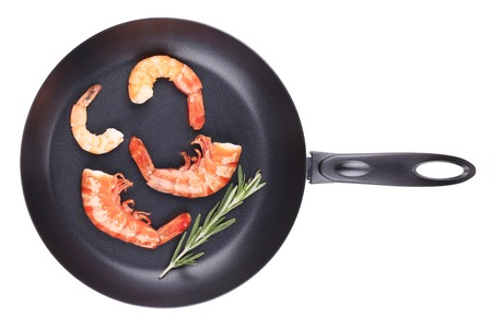 Fresh boiled shrimps on frying pan. Isolated on a white background. photo