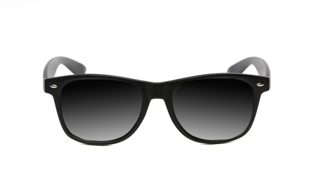 Black sunglasses close up. Isolated on a white background. photo