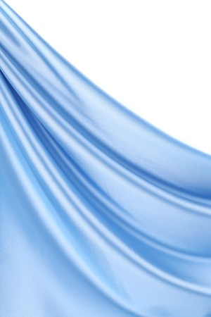 Close up of blue silk fabric background. Whole background. photo