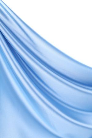 Primer plano de fondo azul de la tela de seda. Todo el fondo. photo