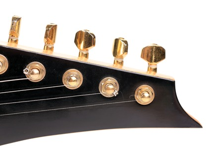 Electric guitar head on white background photo