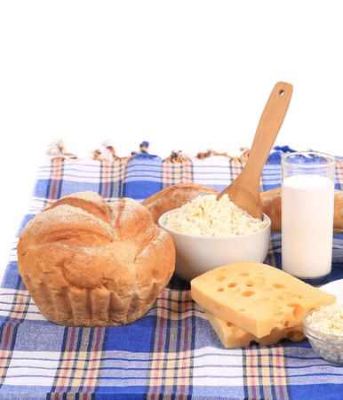 Composition with bread ,milk and cheese  Isolated on white background photo