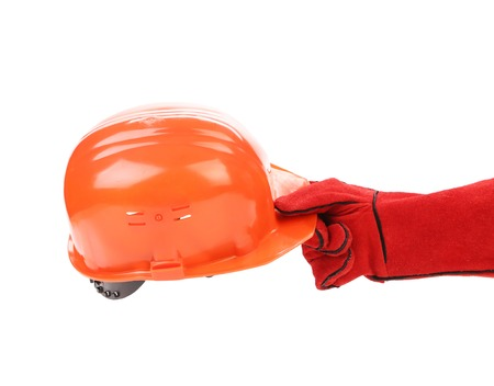 Hand holding a hardhat on a white background photo
