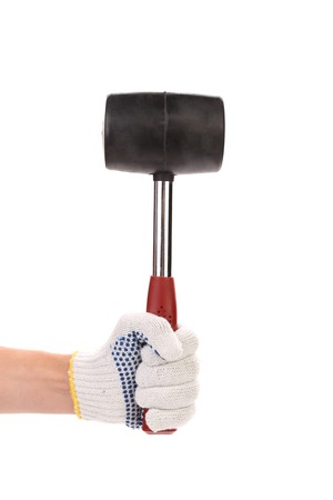 hand with rubber mallet on white background photo